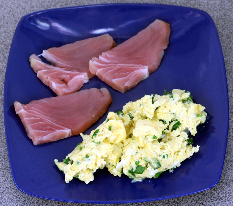 Scrambled duck eggs with garlic chives and raw tuna