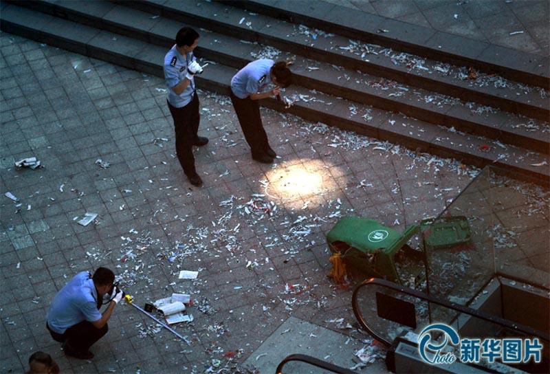 Police examine bomb scene - 29th June 2014